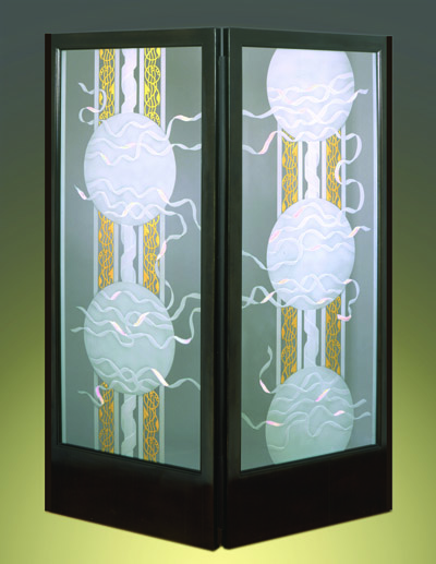 Sand blasted glass art on doors connections Ernie Orfila