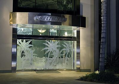 Sand Blasted Glass Art on doors Purefitness Entry by Ernie Orfila