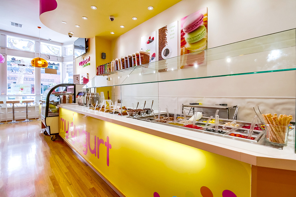 Yogurt ice cream dessert store design back lit counter