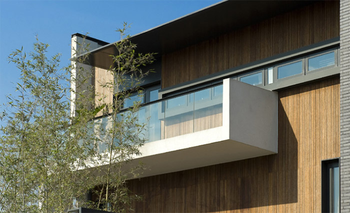 Glass and concrete balcony against bamboo exterior wall
