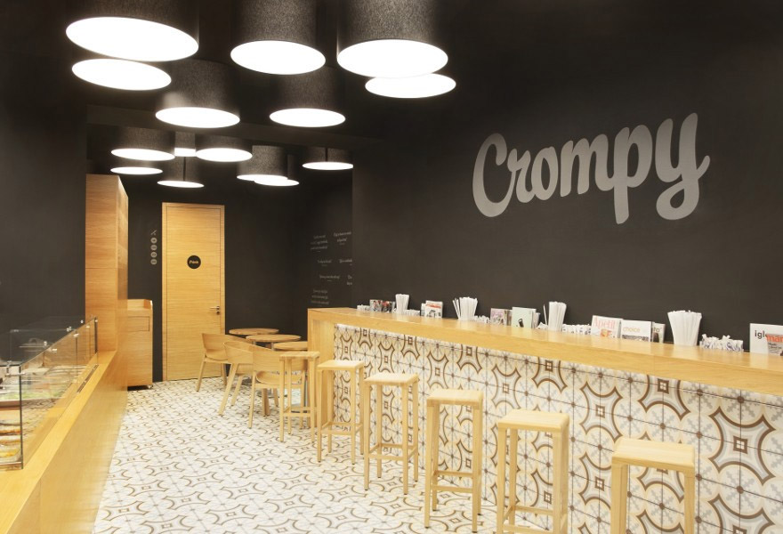 Light floor tile against black walls creates beautiful effect inside food venue