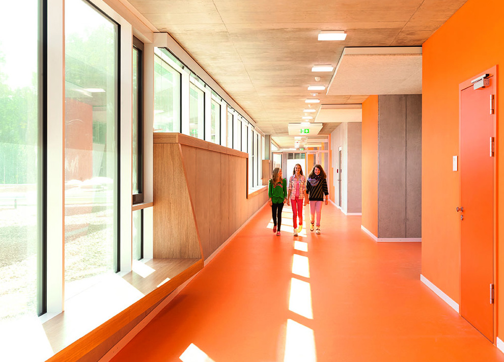 Bright colors in school interior design commercial for Interior designs schools