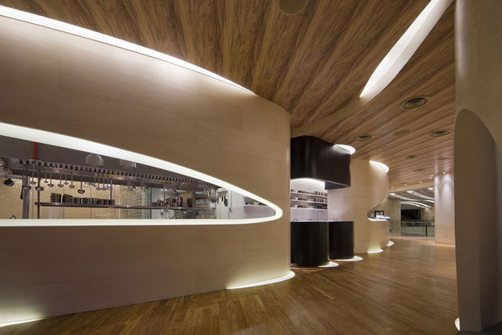 Restaurant Kitchen View unconventional shapes in marine-themed restaurant interior design