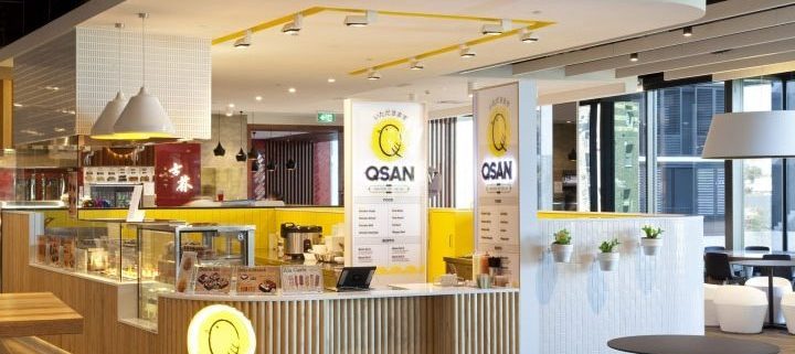 Bright lighting over white and yellow food kiosk