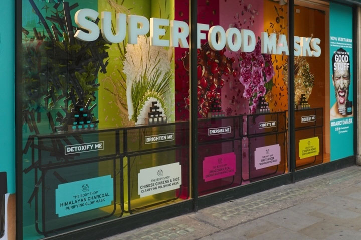 Colorful superfood masks displays in storefront window