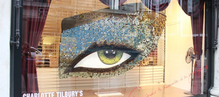 Beauty products arranged in the shape of a giant eye
