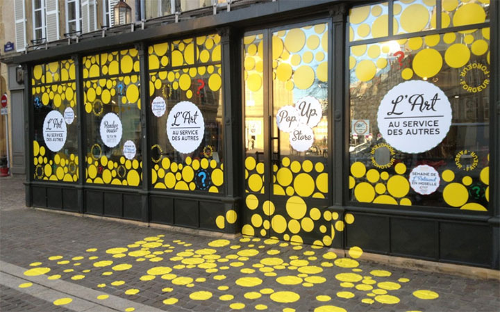 Designing an inexpensive window display with adhesive stickers