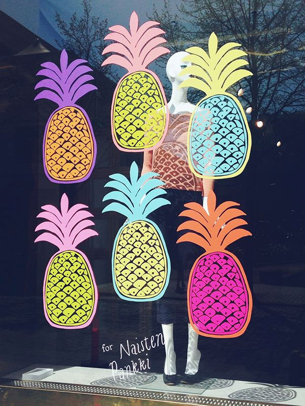 Simple window display decorated with colorful pineapple images