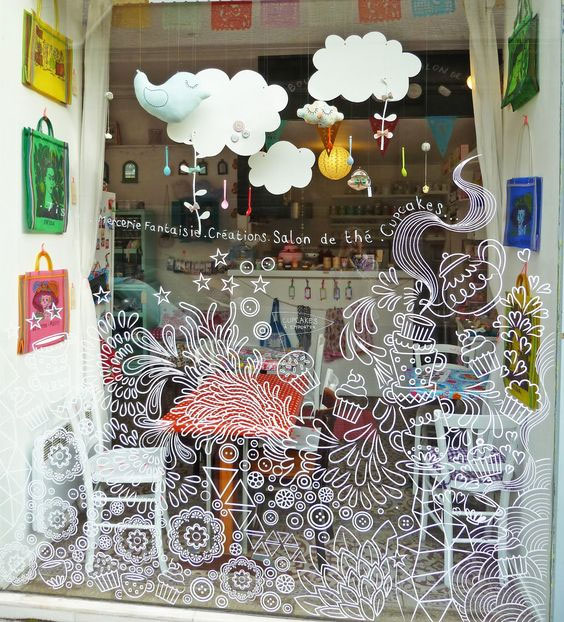 Cupcake store window with drawings and paper decorations