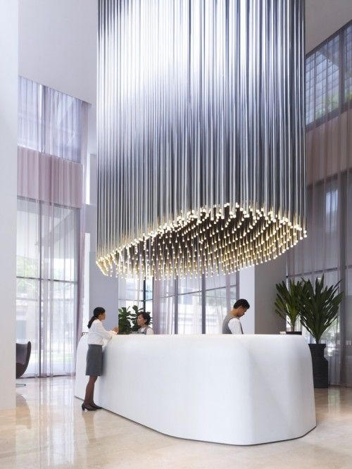 Hotel lobby uses unique cascading lights to draw attention to reception counter