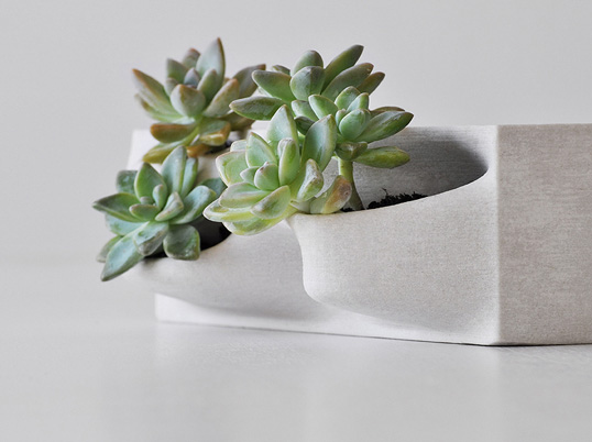 3-D printing material made of naturally occurring substances make for a modern planter