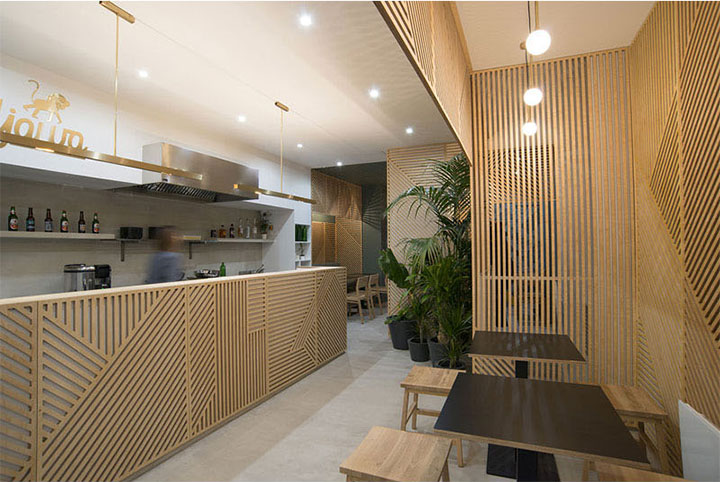 luscious green plants in corners of restaurant mixes with wood panels for a spa look
