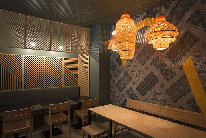 Restaurant interior with plays of lights and shadows created by woven chandeliers