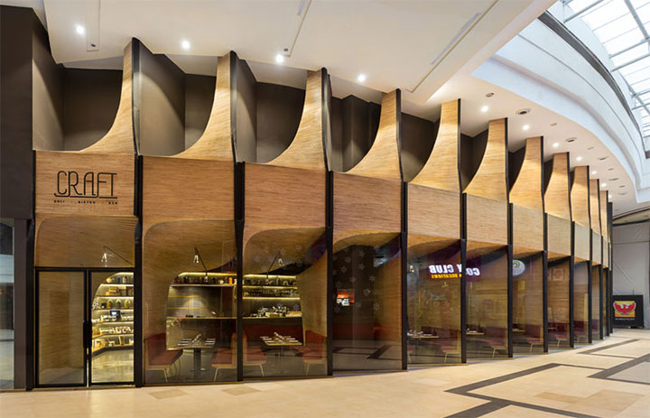 Curved wood structures create a feeling of intimacy in