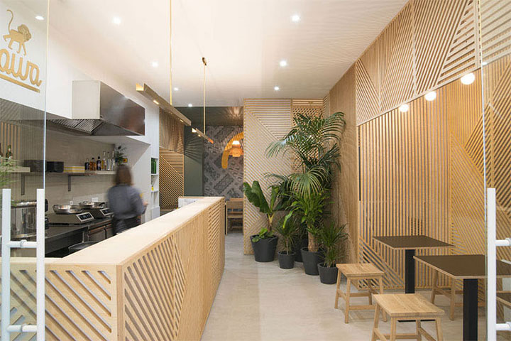 Restaurant interior design in Indonesia uses thin wood panels as wall treatment
