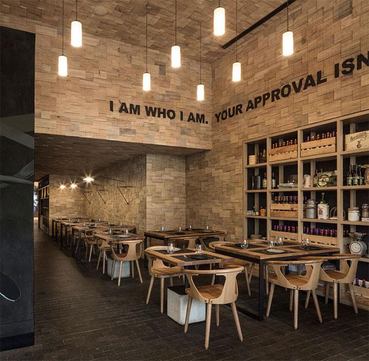 Wood shingle walls and ceilings create rustic restaurant look