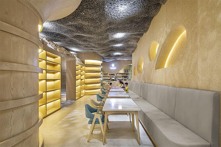 Children's restaurant interior design with futuristic ceilings and organically shaped walls