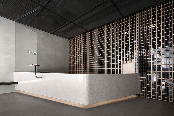 Shiny tile behind counter in modern restaurant