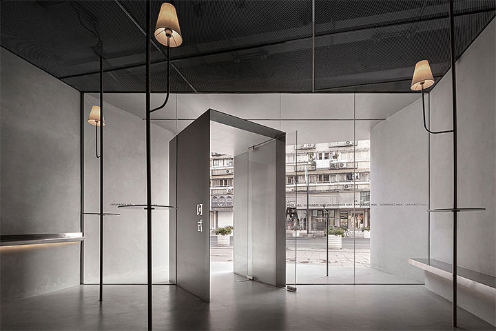 Simpla oblique entrance into a minimalist Chinese restaurant