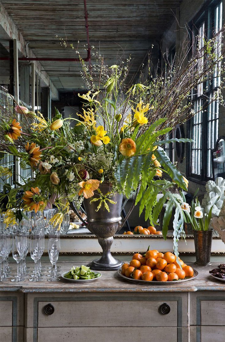 Tall yellow flower arrangement on counter