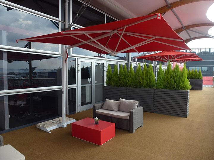 Colorful Retractable Umbrella above Patio Seating Area