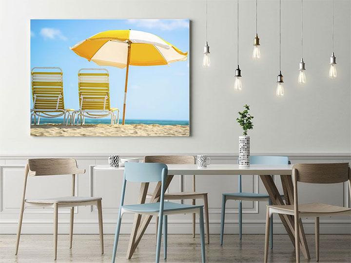 Colorful beach-themed wall print against neutral interior