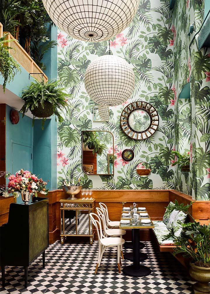 Wallpaper with lush vegetation creates striking summer restaurant decor