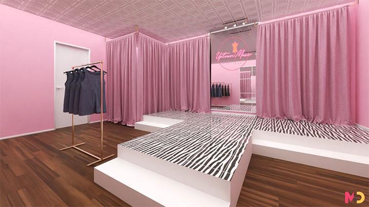Zebra-pattern catwalk framed by pink draperies in women's clothing store