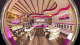Colorful frozen yogur shop design with pink and purple curved soffits