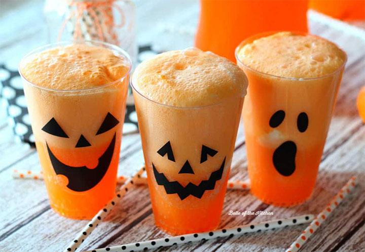 Orange Halloween Fanta drinks in pumpkin plastic cups