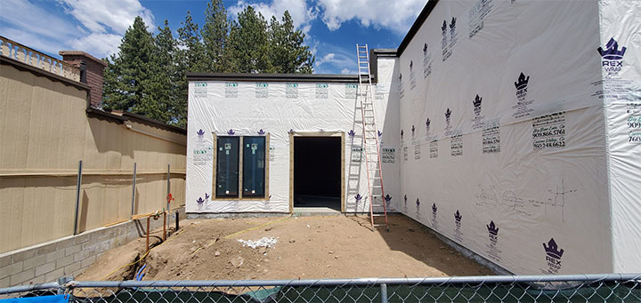 Front of building under construction to house frozen yogurt shop