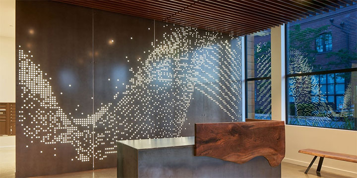 Perforated aluminum sheet used as a divider in office interior design