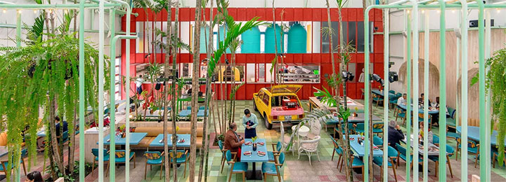 Unconventional cafe interior ispired by greenhouse concept