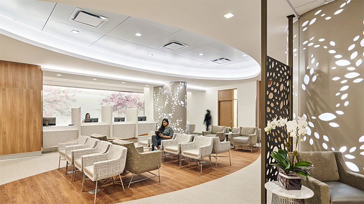 Laser-cut metal panel with leaf pattern in medical office interior