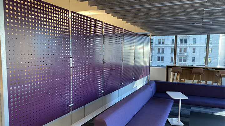 Row of perforated metals sheets used as dividers in office design