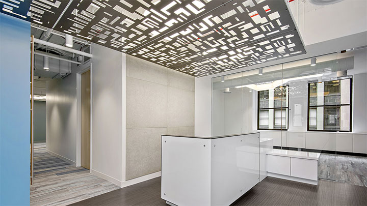 Aluminum panels with geometric design used as a ceiling treatment