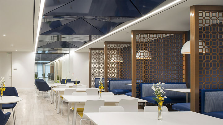 Vertical panels with geometric design separate tables in cafeteria