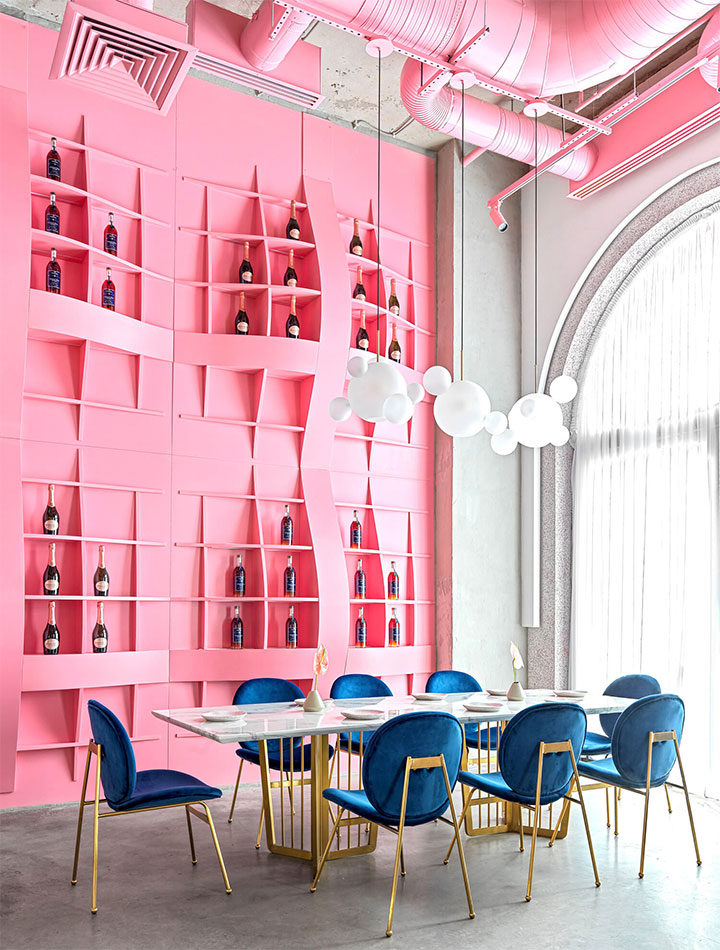 Pink ceiling-high wine rack in restaurant interior