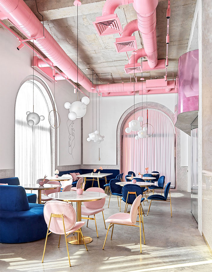 Elegant combination of industrial and soft accents in restaurant interior