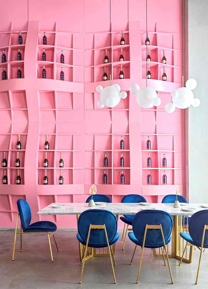 Cloud-like wine rack in pink restaurant design