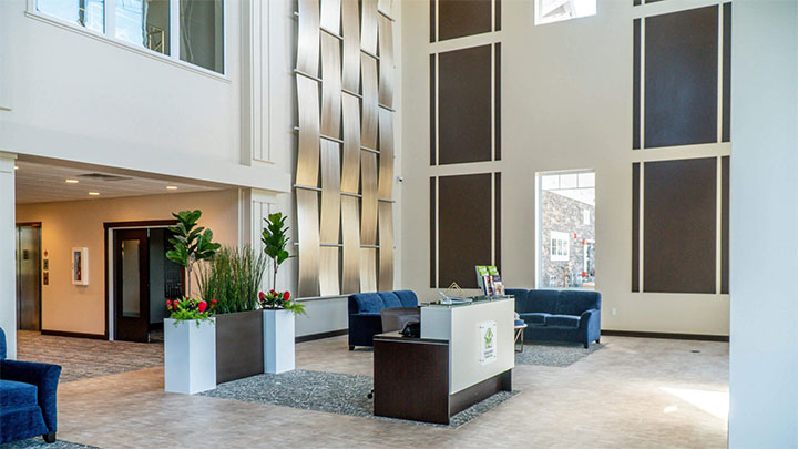 Metal panels create a weave patterns against the wall of a lobby